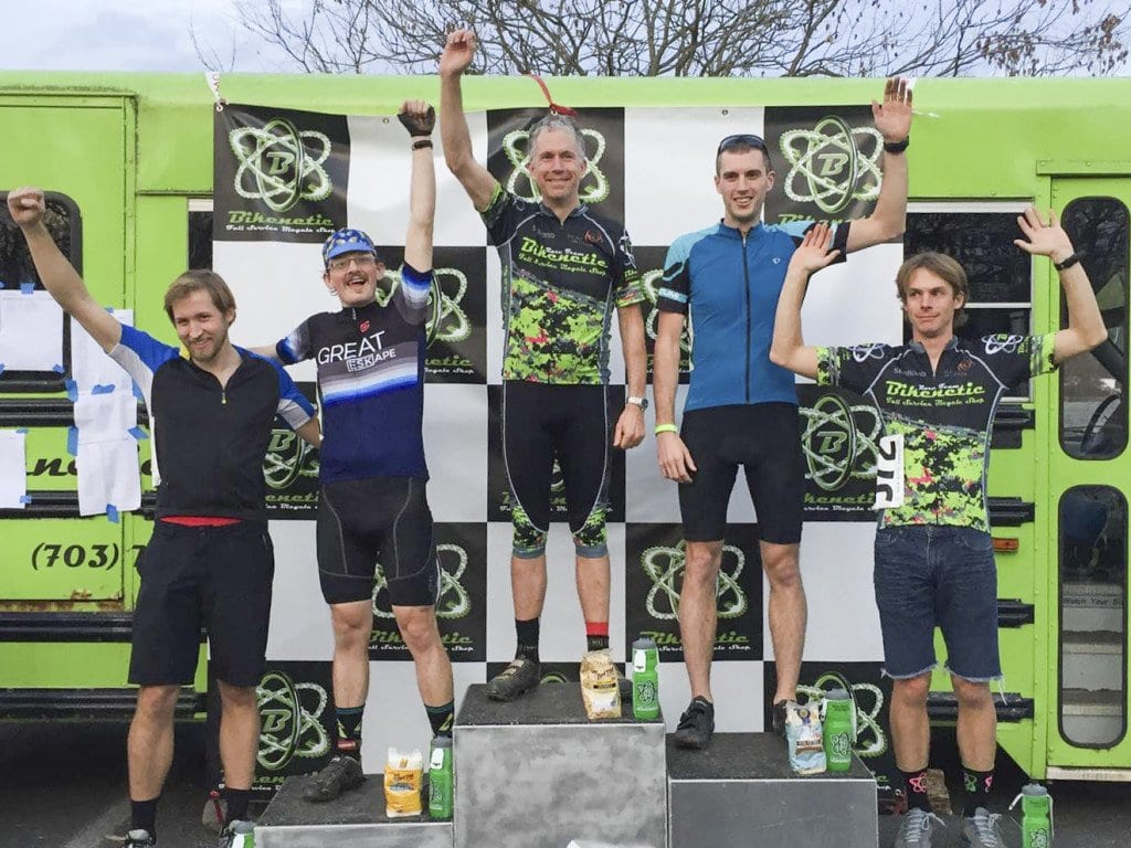 Falls Church City Manager Wyatt Shields (center) stands atop the winner's podium. (Photo: Courtesy of Patty Shields)