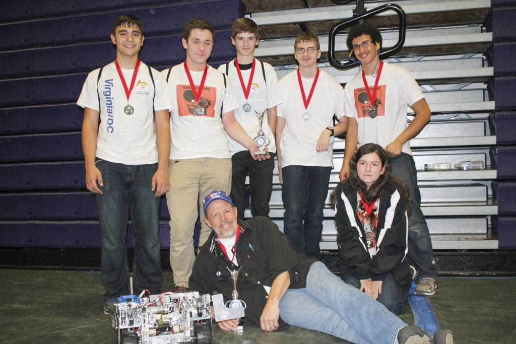 The George Mason High School robotics team with their competition-winning robot. (Courtesy Photo)