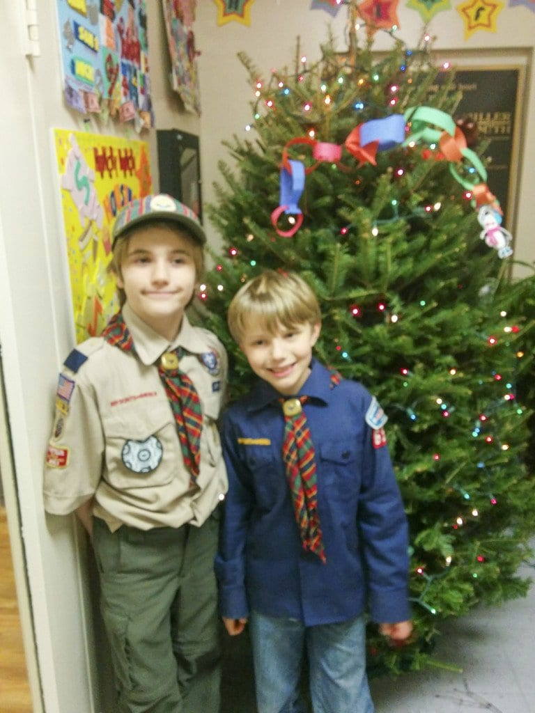 Cub Scouts Kyle Wilson and Victor Pilson delivered some early holiday cheer to the local family homeless shelter. Pack 657 donated Target gift cards, treats, and a Christmas tree festooned with scout-crafted ornaments. (Photo: Courtesy of John Wilson)