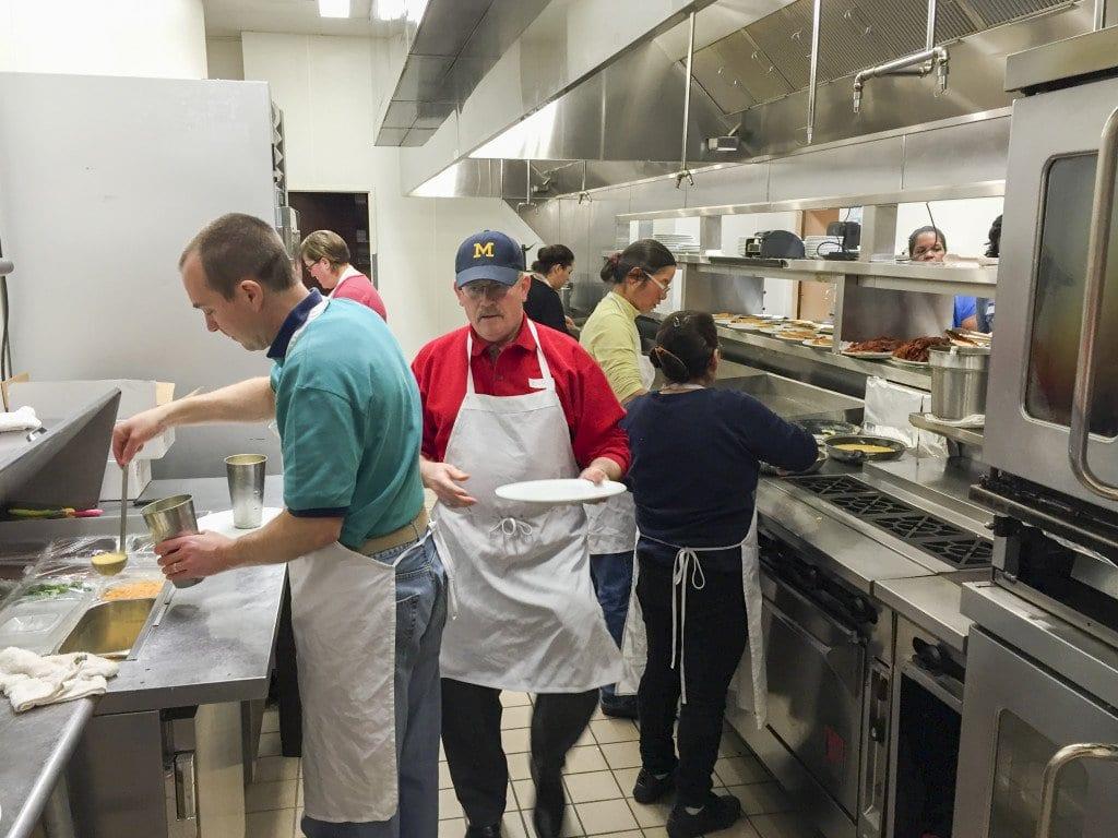 Volunteers help prepare meals for the breakfast. (Photo: Courtesy of  Jeff Bulman)