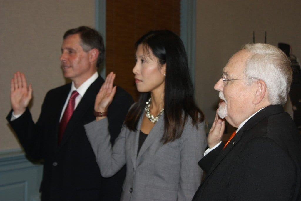 SWORN IN MONDAY  to new four year terms on the Falls Church City Council after winning the heated election last month were (left to right) Mayor David Tarter, Letty Hardi and Councilman Phil Duncan. Tarter and Duncan resumed their service on the Council tonight, while Hardi will assume her seat on the dais on the first of January. (Photo: News-Press)
