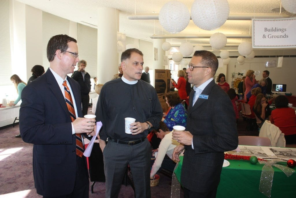 FALLS CHURCH EPISCOPAL'S warden Mark Hadley (left) is shown chatting with its rector, the Rev. John Ohmer (center) and junior warden Raleigh Griffith between services this morning when Hadley announced to the congregation the signing of the lease for the Southgate Center. (Photo: News-Press)