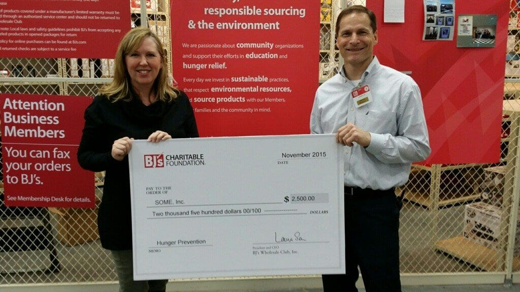 Director Tracey Peranich (left) of SOME Inc. and BJ's General Manager Larry Solinsky. (Courtesy photo)
