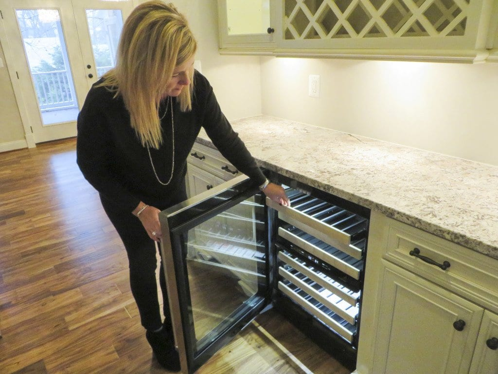 Jennifer Landers, the president of New Dimensions, Inc., shows off a wine cabinet in the new home at 6521 33rd Street. (Photo: Patricia Leslie/News-Press)