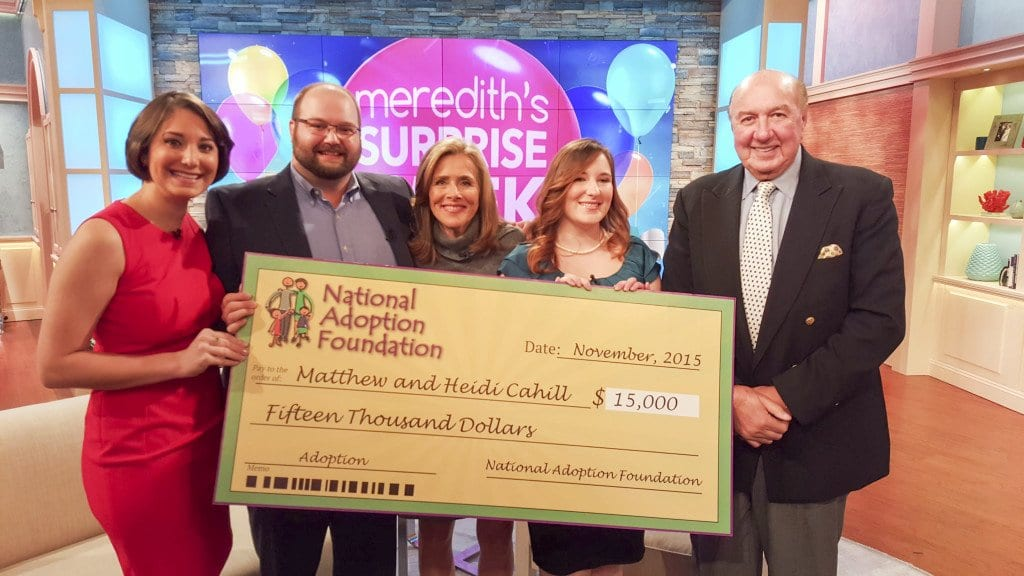 Heidi and Matt Cahill received a check for $15,000 from the Goldberg Family and the National Adoption Foundation to go toward their adoption costs on the Meredith Vieira Show. (L to r) the Cahills, Veira and Danielle and Norman Goldberg pose for a photo on the set of Vieira's show. (Photo: Courtesy of Heidi Cahill)