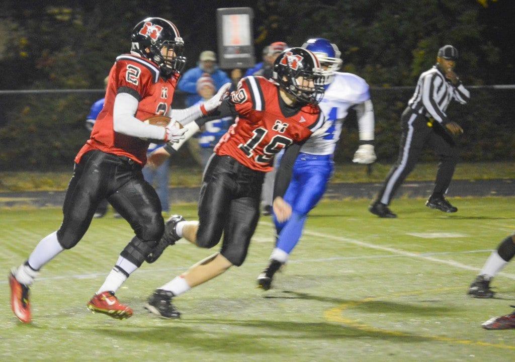 Mason junior Dustin Green (left) runs the ball against Madison County on October 30. (Photo: Kate Karstens/News-Press)