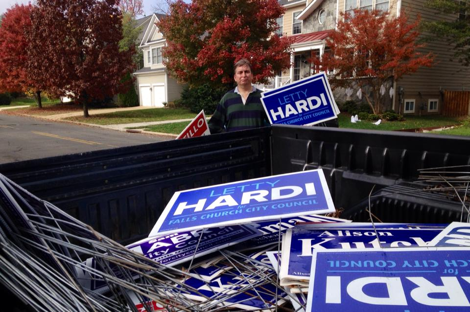 TOM CLINTON GETS READY to throw some of the 2015 candidates' campaign signs into the back of his pickup truck. Clinton and City councilmember Phil Duncan have been picking up campaign signs after Election Day since 2000. (Courtesy Photo)