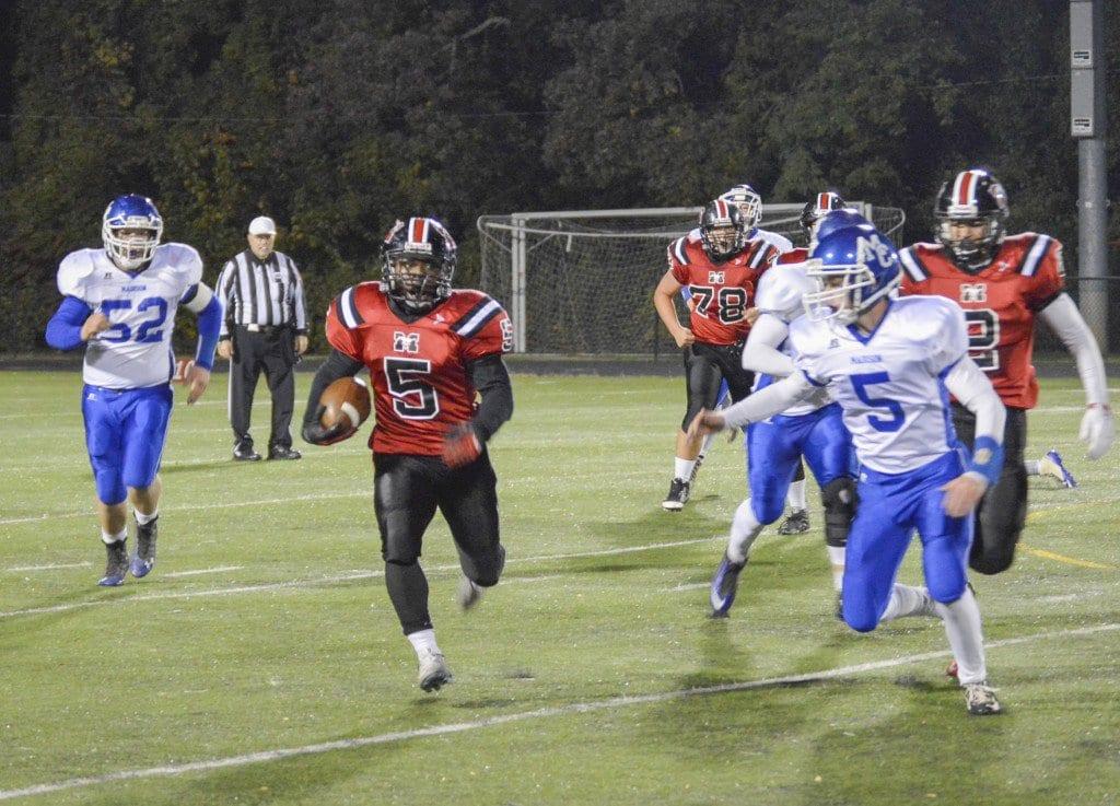 Mason senior running back D'Montae Noble breaks a run against Madison County High School. (Photo: Kate Karstens/News-Press)