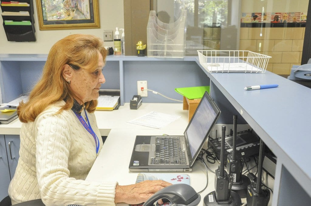 Margaret Ohr, who has been working at Thomas Jefferson Elementary School for 37 years, checks her email at the end of her work day. She is set to retire from Jefferson on Friday, Oct. 30. (Photo: Drew Costley/News-Press)
