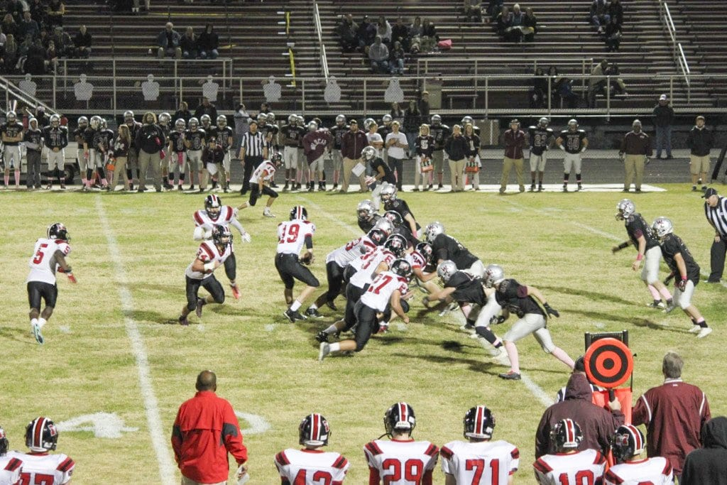 Mason's offense tries to run the ball against Warren County High School's defense during their win against the Wildcats on Friday, Oct. 23. (Photo: Courtesy of FCCPS Photo/Kevin Creed)