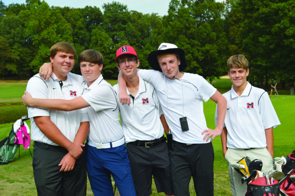 Golf Team members (from left to right) Daniel Schlitt, George Gillan, Noah Anderson, Devin Thomas and Nicholas Wells pose for a photo at the Penderbrook match. Despite having lost this match, the team is optimistic about the upcoming postseason. (Photo: Matthew Ng)