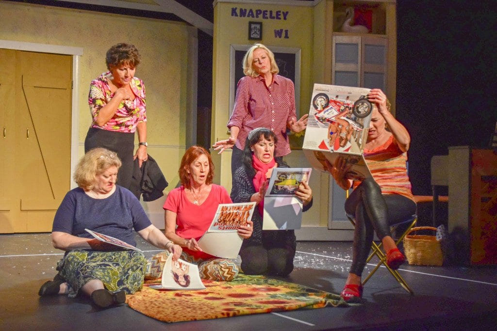 """The ladies of the Knapeley WI club contemplate an """"alternative"""" calendar in the Providence Players production of Tim Firth's """"Calendar Girls,"""" which opened the Providence Players' 18th season last week. (Photo: Courtesy of Providence Players of Fairfax)"""