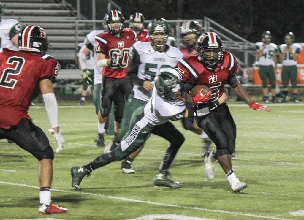 Mason rusher D'Montae Noble rushes for a gain against William Monroe High School during the Mustangs' September 25th win over the Dragons. Noble played a key role in the Mustangs' defeat of Strasburg High School last Friday. (Photo: Courtesy of K.A. Creed)