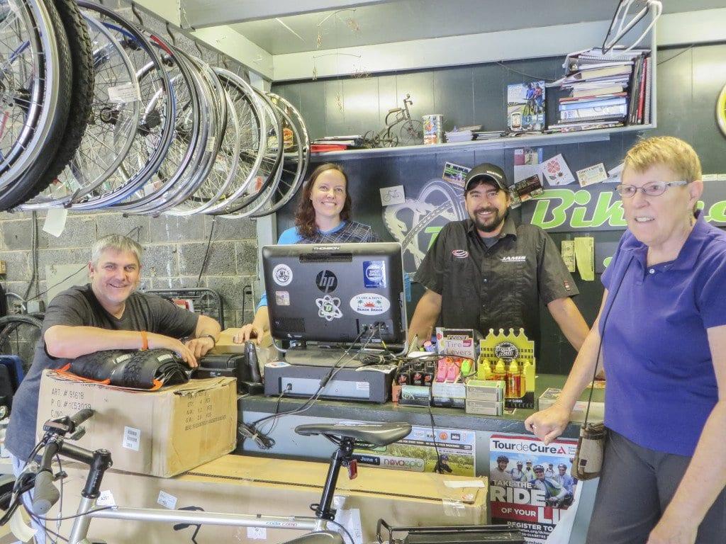 At Bikenetic (l to r) are author Martin Fernandez, Bikenetic owners Helen Huley and Jan Feuchtner, and customer Kathleen Wilson. Fernandez writes about biking. (Photo: News-Press)