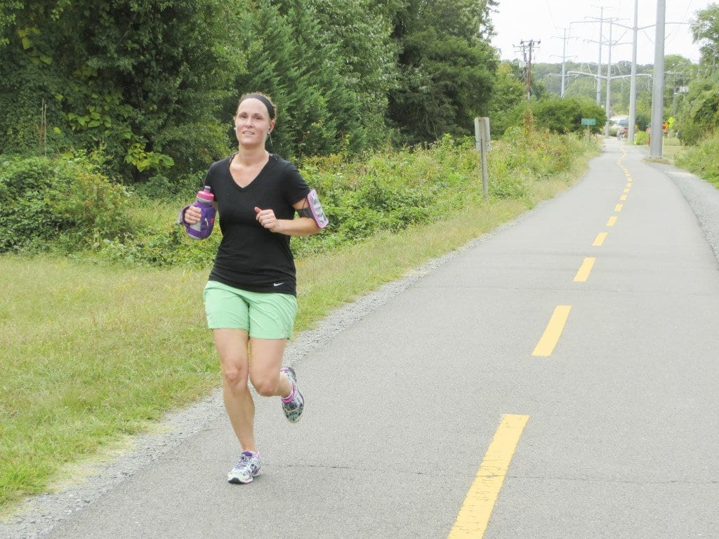 """LESIA LAMPTON RUNS on the W&OD Trail. She said that motorists were """"respectful"""" of runners, except for """"maybe"""" the intersection of Shreve Road at Virginia Lane, near Shrevewood Elementary School.  (Photo: News-Press)"""