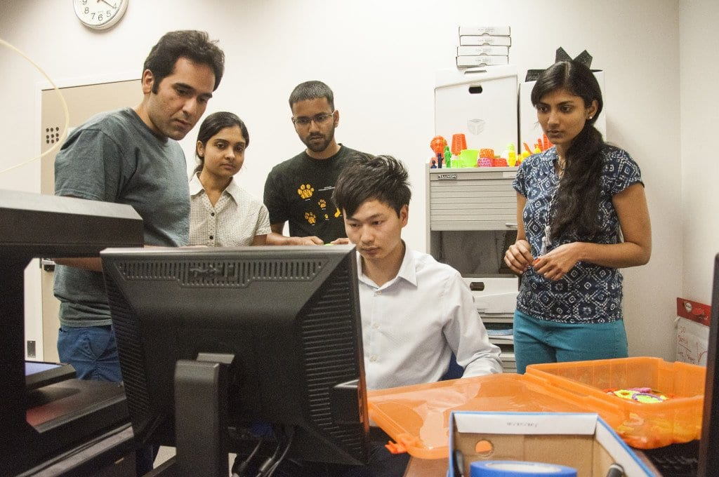 Junbo Zhao, a PhD candidate in electrical and computer engineering at Virginia Tech, shows his fellow students, (l to r) Kaveh B. Kelarestaghi, Shalini Sankaranarayanan, Amal Chacko and Harshala Sardar one of the many 3D printing projects that can be executed in Virginia Tech's Maker Lab. (Photo: Drew Costley/News-Press)