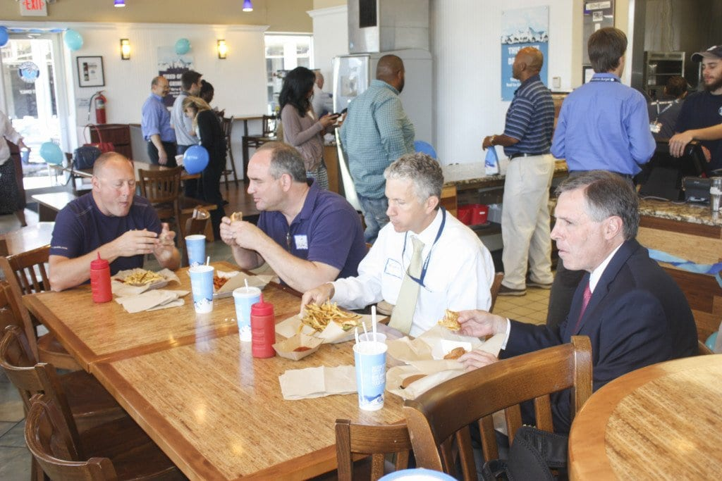 (R TO  L) Mayor Dave Tarter, City Manager Wyatt Shields, Falls Church Chamber of Commerce member and local business leader Tom Gittins and Elevation Burger's founder and chairman Hans Hess eat together during the company's celebration of its 10-year anniversary. (Photo: News-Press)