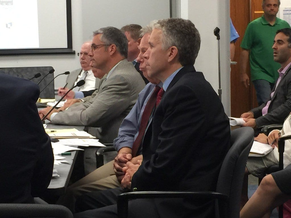 MASON ROW DEVELOPER Peter Batten (leaning forward in the center) presented the latest plan to a work session of the F.C. City Council Tuesday night. F.C. City Manager Wyatt Shields is in the foreground. (Photo: News-Press)