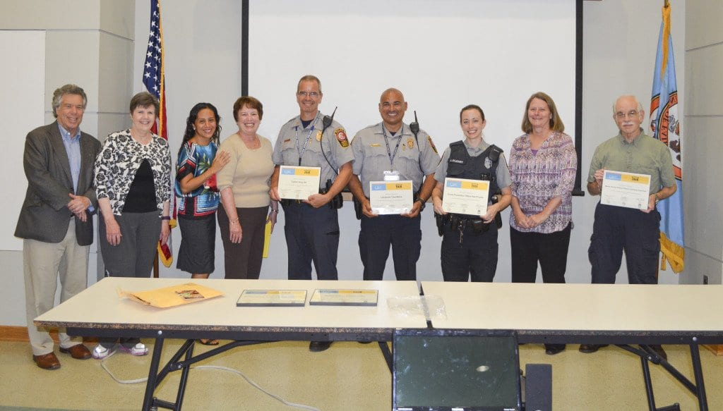 The Rotary Club of Bailey's Crossroads presented awards to members of the Mason District police station. Pictured (from left) David Feld, Pat Borowski, Alejandra Caballero, Glad Hatchl, Captain Andy Hill, Lieutenant Tony Matos, Officer Kat O'Leary, Kate Walter and Gabe Goldberg. (Photo: Courtesy of David Borowski)