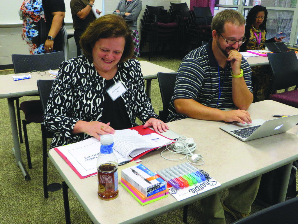 """NEW CITY OF FALLS CHURCH teachers Gina Thacker (left) and Nicholas Bajis in """"class"""" at the new teacher orientation at George Mason High School on Monday. (Photo: Patricia Leslie)"""