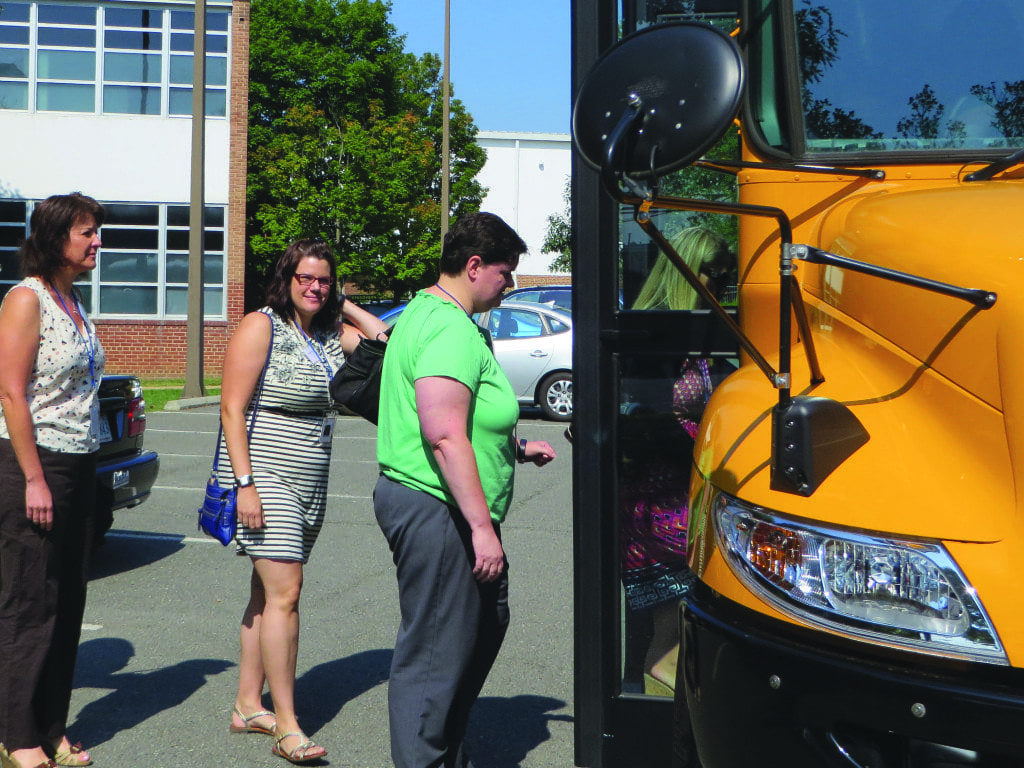 TEACHERS board a bus for a tour of Falls Church at the F.C. City Schools' new teacher orientation on Monday. (Photo: Patricia Leslie)