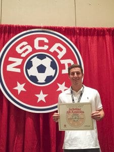 Mason grad Ned Quill holding after being honored as an All-American by the National Soccer Coaches Association of America. (Courtesy Photo)
