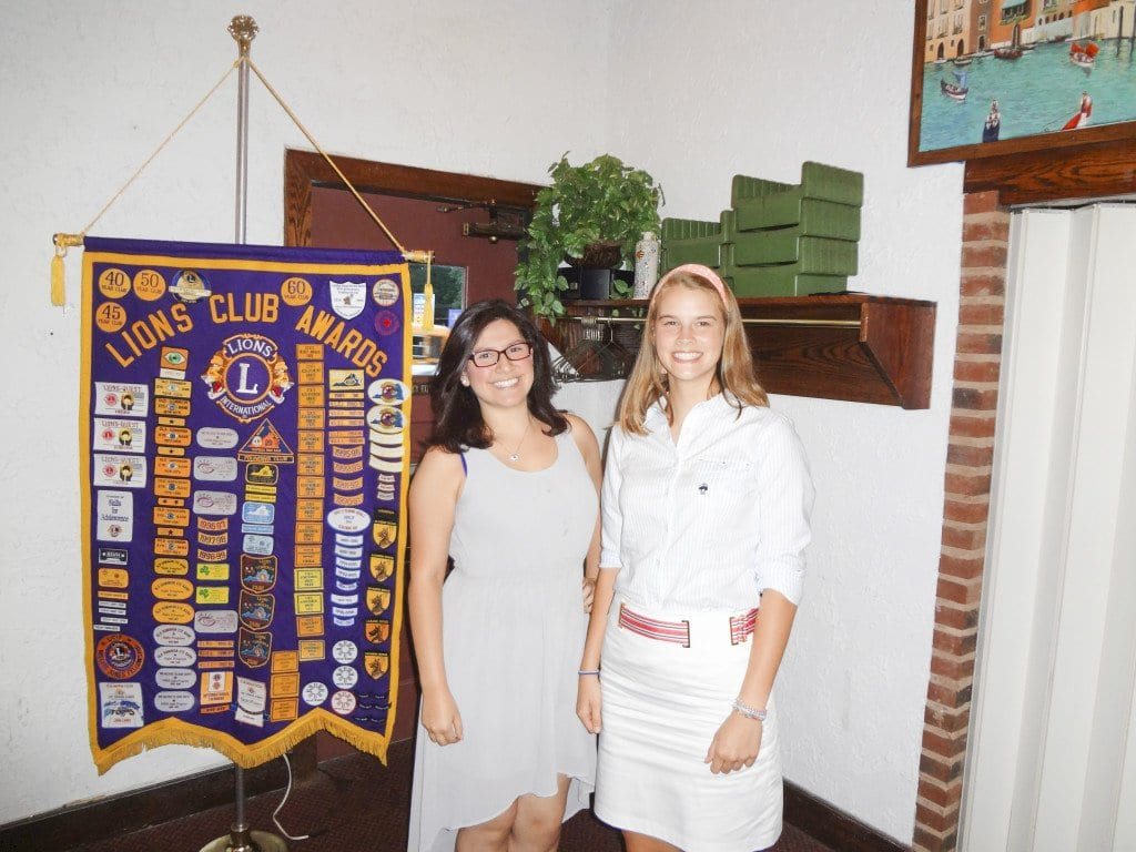 George Mason High School senior Katie Cheney (right) and Falls Church High School senior Julia Alexandra Rodriguez were presented with scholarships at the Falls Church Lions Club's meeting on Tuesday. (Photo: Courtesy of Barry Buschow)