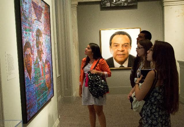 Flor Jasmin Cruz Chavez (center) checks out one of the pieces at the National Portrait Gallery, where she'll be interning this summer. (Courtesy Photo)
