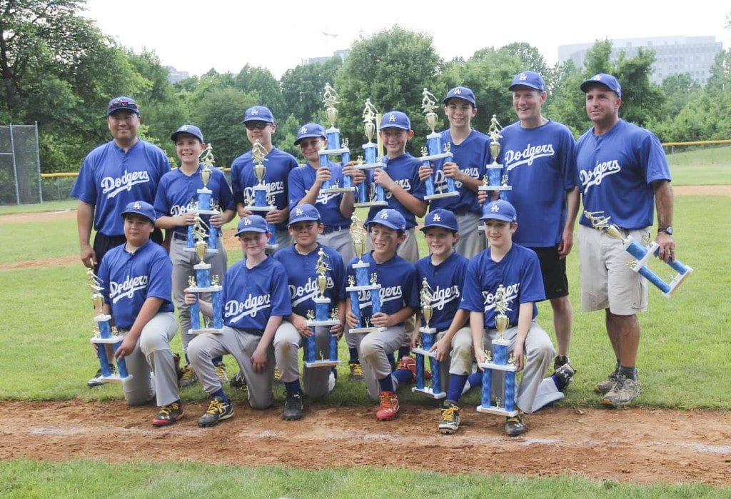 THE DODGERS hold their championship trophies after defeating the Orioles 4-3 to win the Falls Church Kiwanis Little League Major divsion championship. (Photo: Courtesy of Michael Trauberman)