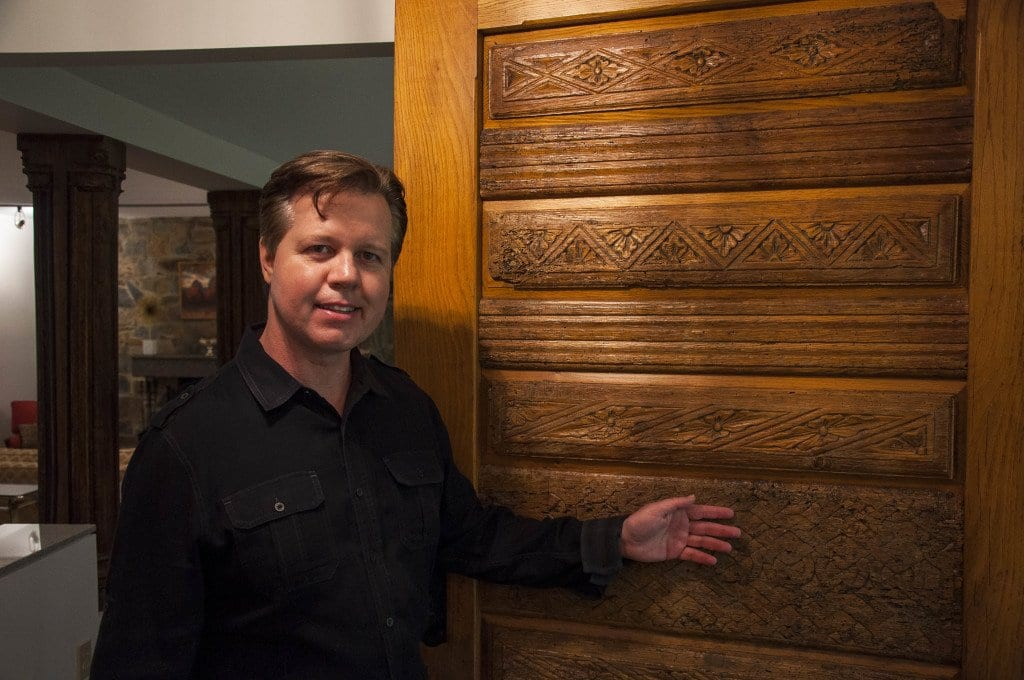Real estate agent Ken Trotter shows off the antique wood carvings in the door of the Lake Barcroft home. (Photo: Drew Costley/News-Press)