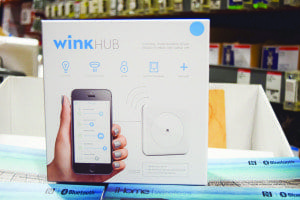 "According to Manuel Avalos, a sales associate at the Falls Church Home Depot, the Wink smart home hub is ""the most basic, bottom line thing you can buy."" The hub connects to the the wireless router and allows users to control smart home devices and allows users to control all of their smart homes devices, regardless of brand, with a smartphone app. (Photo: Liz Lizama)"