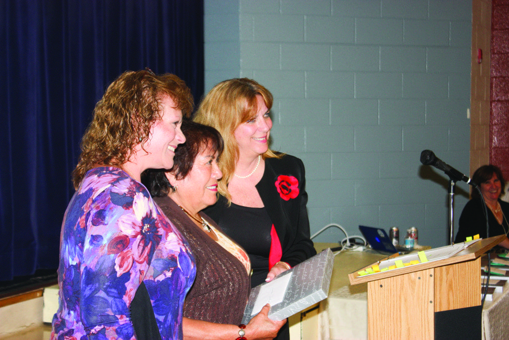 AT A SPECIAL RECEPTION to honor those retiring from employment with the City of Falls Church Schools Tuesday, Sixteen teachers and others were feted, including Yolanda Jordan (center), a long-time bus driver who was introduced by Nancy Hendrickson (left) and presented a plaque by Schools Superintendent Dr. Toni Jones (right) (Photo: News-Press)