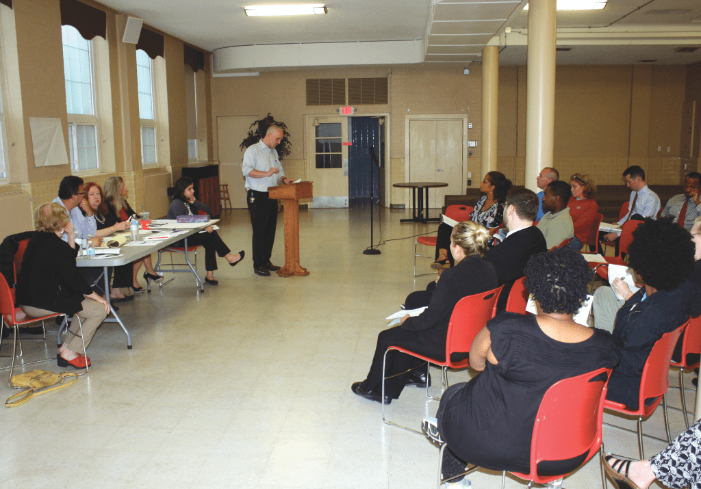 TENANTS FACED OFF with management of the aging Broadfalls Apartments at a meeting of the Falls Church Housing Commission Tuesday night in a meeting hall at the St. James Church. Many grievances were aired and promises of improvements, but rents will still rise and the building's plumbing system will not be overhauled. (Photo: News-Press)