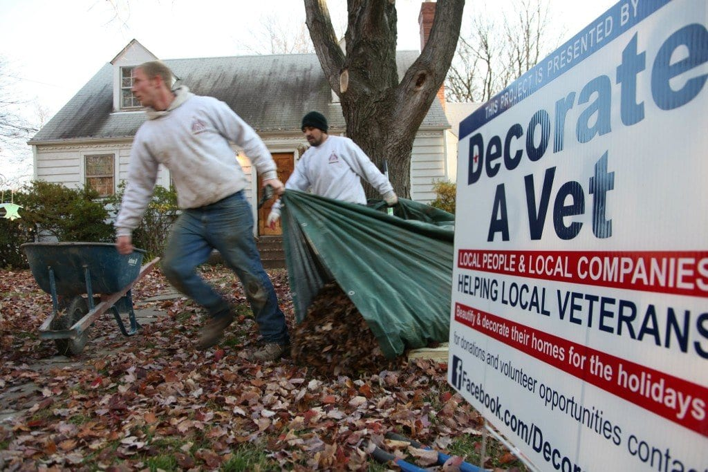 A crew of veterans goes to work on a local veteran's home as part of the Decorate a Vet organization's work. (Photo: Courtesy of Jeff Jones of Stonescaping and Gardens)