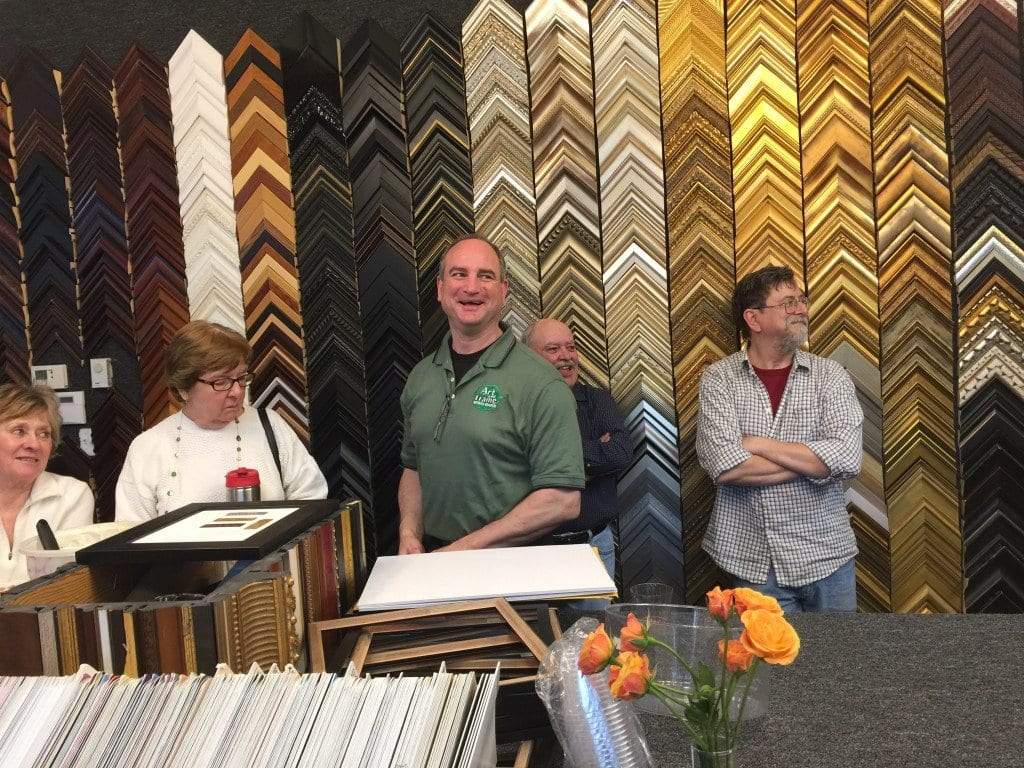 Tom Gittins (center) shows off the new Art & Frame of Falls Church locations. (Photo: News-Press)