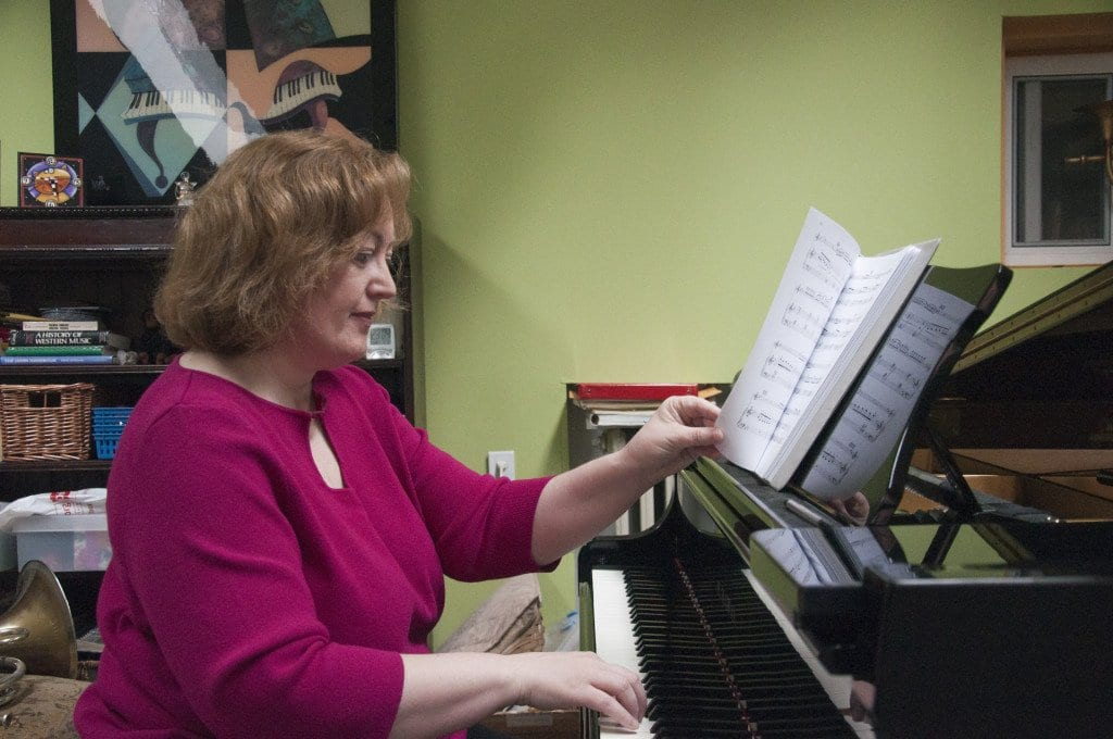 Lisa Emrich, the chair of communications for iConquerMS, practices for an upcoming performance. Emrich, who was diagnosed with multiple sclerosis in 2005, has been blogging about her experience living with the disorder since 2007. (Photo: Drew Costley/News-Press)