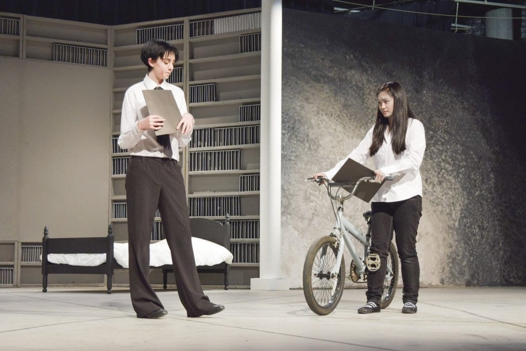 """Lead character Jonas, played by Bailey Singer, talks to his little sister Lily, played by Danielle Phan, after being selected as the Receiver of Memories in a rehearsal for Falls Church High School's production of """"The Giver."""" (Photo: Liz Lizama/News Press)"""