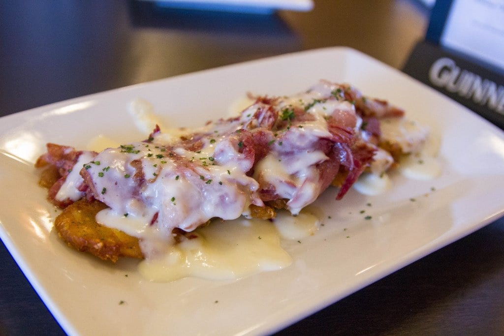 Irish boxty, or potato pancakes, are covered in a Whiskey-leek cream sauce and corned beef. (Photo: Jody Fellows)