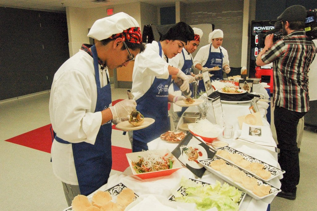 Marshall High School's Culinary Academy team of Brian Andrade, Anthony Panetta, Alex Cerda Obando and Stephen Pungello preparing their winning meal during the Real Food For Kids' third annual Feeding Academic Success Culinary Challenge on March 10 at Marshall. (Photo: Jennifer Cypher)