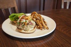 Mad Fox's Albacore Tuna Burger incorporates cucumber, radish slaw and yuzu aioli. (Photo: Drew Costley/ News-Press)