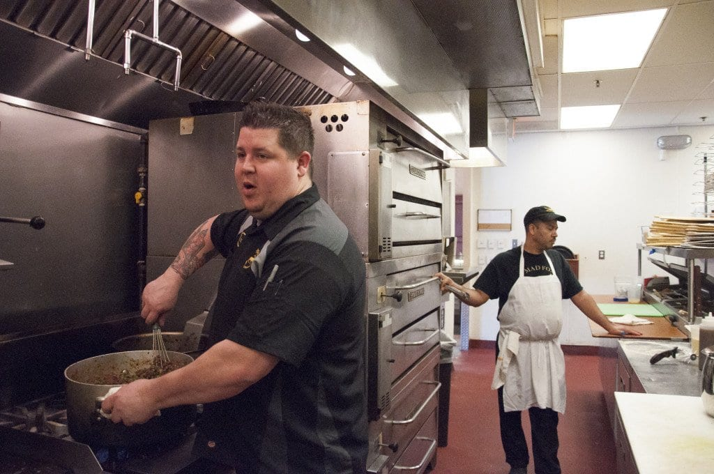 mad fox executive chef Travis weiss (left), stirs the filling for the restaurant's St. Patrick's Day Sheppard's Pie. Weiss is currently conceiving dishes for the restaurant's spring menu, which he plans to roll out in mid-April. (Photo: News-Press)