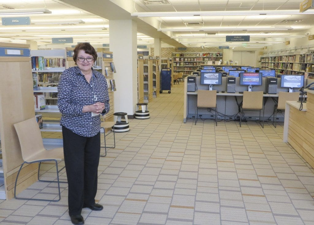 Kathy Young, assistant branch manager at the Woodrow Wilson Library, can't wait to welcome visitors to the new library which has 24 computers. (Photo: Patricia Leslie/News-Press)