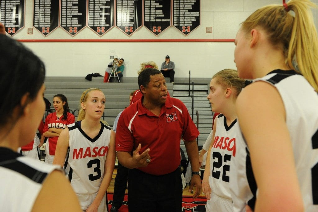 Mason girls basketball coach LaBryan Thomas (center) in a huddle with his 2013 team, which made a run to the state championship game. (Photo: FCCPS Photo)