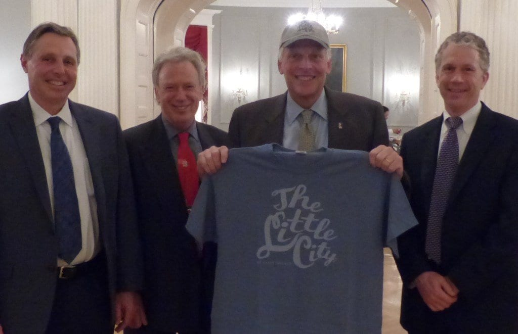 Virginia Governor Terry McAullife (holding shirt) with (left to right) Falls Church Mayor David Tarter, F.C. Economic Director Rich Goff and City Manager Wyatt Shields. (Photo: City of Falls Church)