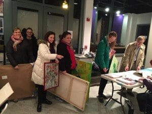 Artists in Falls Church Arts' Green show arriving to drop off their work. Artists (l to r) Caitlin Hillyard, Brian Legan, Donna Byrne, Wendy Hicks, June Jewell and John Maier sign in with artist Dee Ellison. (Photo: Courtesy of Barb Cram)