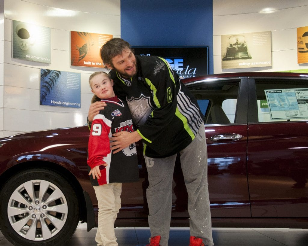 Ann Schaab (left) with Washington Capitals star Alex Ovechkin at Bill Page Honda in Falls Church after Honda gave him a car to donate to the American Special Hockey Association, which Ann plays in. (Photo: News-Press)