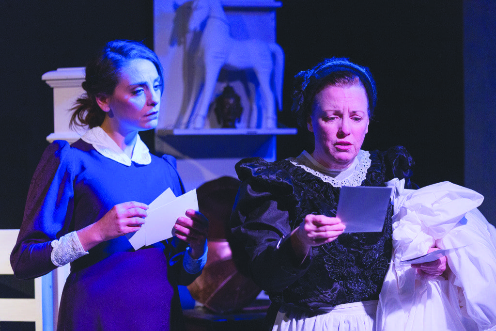 """In """"Turn of the Screw,"""" Susan Derry (left) plays Miss Giddens, who looks on while Mrs. Grose, played by Sherri Edelen, reads. (Photo: Courtesy of Keith Waters/Kx Photography)"""