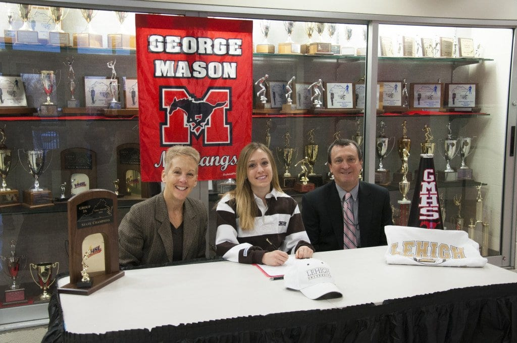 George Mason senior Ava Roth (center) with her parents, Barb and Jesse, at a signing ceremony held at Mason this morning. Roth signed a letter of intent to play soccer for Lehigh University. (Photo: News-Press)