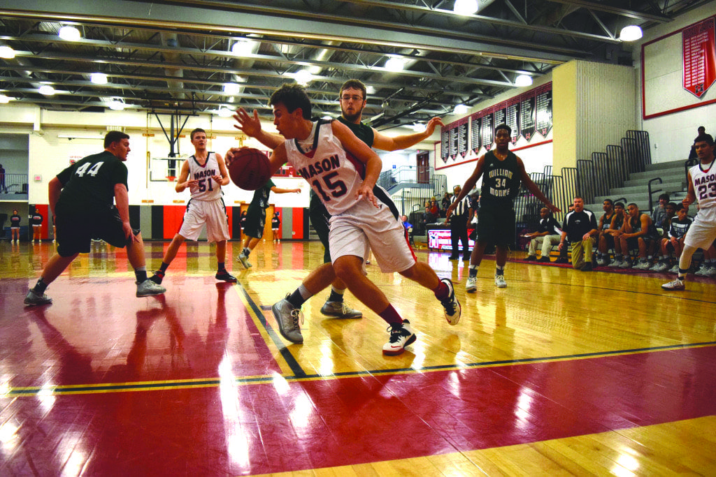 mason junior elliot mercado (center) takes the baseline during the Mustangs 55-36 win over William Monroe. He led Mason with 20 points in the game. (Photo: Liz Lizama/News-Press)