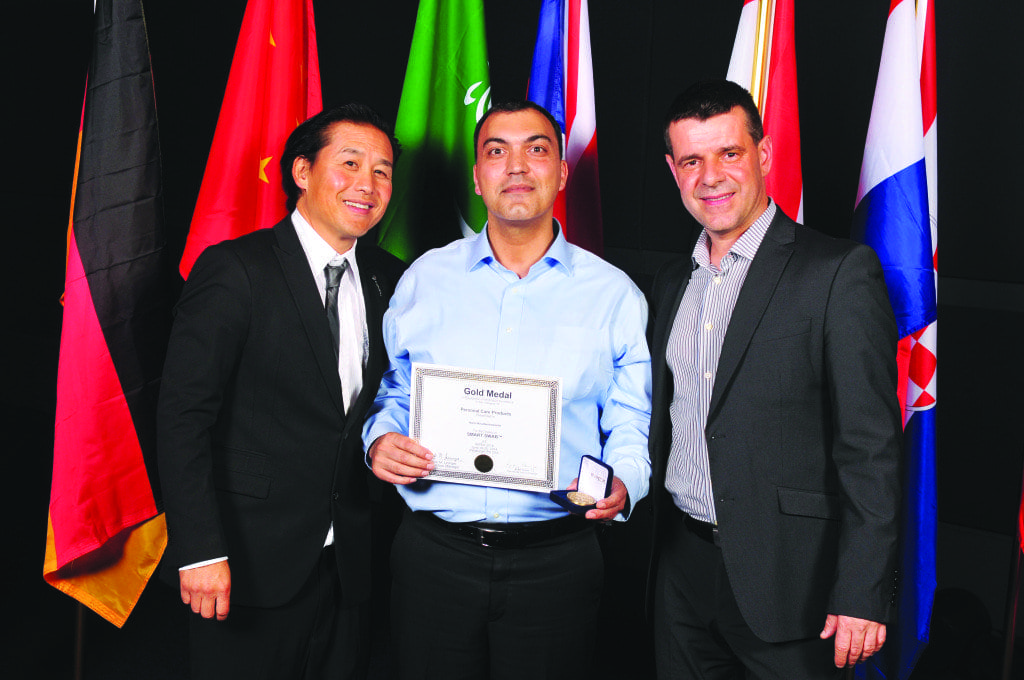 Local resident nami khadem (center) won the juried gold medal for medical products at the annual Invention and New Production Exposition in Pittsburg last year for his Smart Swab, which innovates on the classic cotton swab with the aim of making it safer to use. (Photo: Courtesy of Nami Khadem)